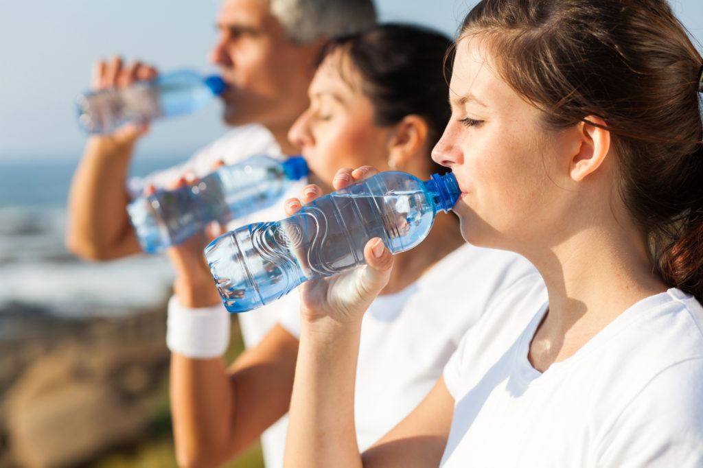 Active Family Drinking Water After Jogging